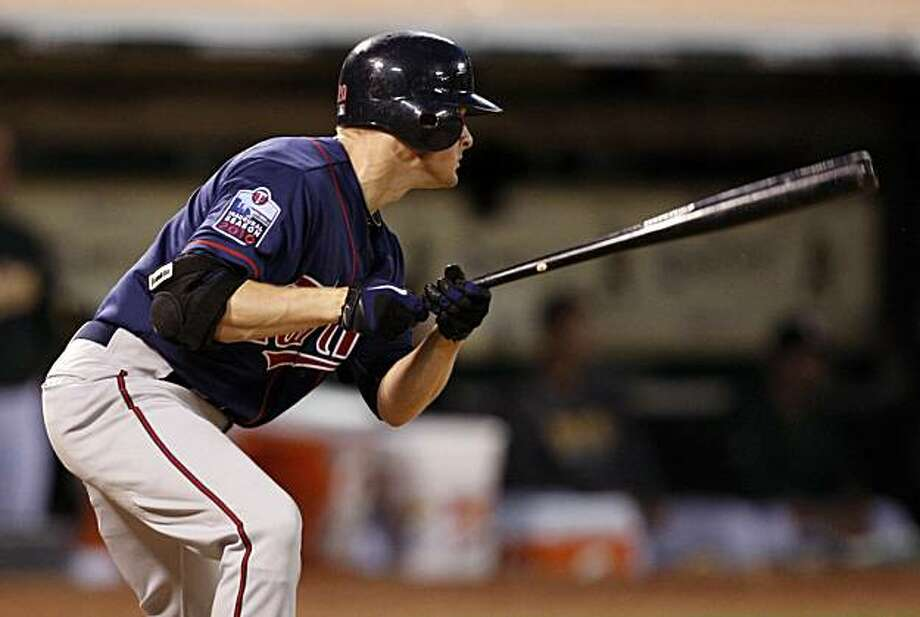 Minnesota Twins' Matt Tolbert watches his RBI single hit off  Oakland Athletics' Brad Ziegler in the ninth inning of a baseball game Saturday, June 5, 2010, in Oakland, Calif. Photo: Ben Margot, AP