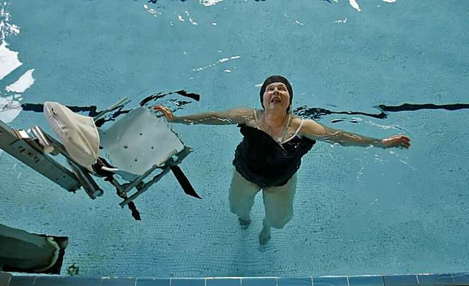 "Katya Rochell, 69, floats as she gets off the seat in the warm water at the Berkeley pools, Friday June 6, 2010, in  Berkeley, Calif. She has had two knee replacements and said, "" when I learned to swim I realized I could float like Ivory soap."" Photo: Lacy Atkins, The Chronicle"