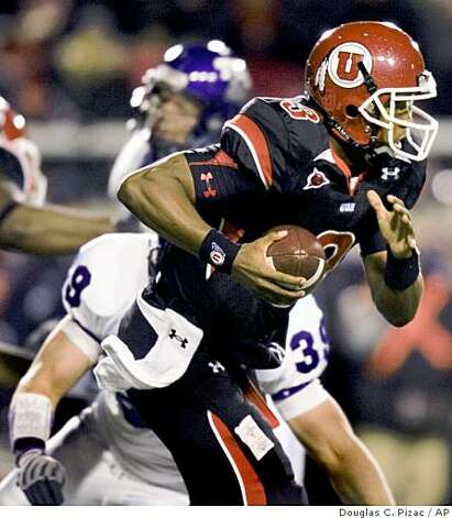 Utah quarterback Brian Johnson (3) is sacked by TCU linebacker Jason Phillips (39) for a four-yard loss during the first quarter of an NCAA college football game Thursday, Nov. 6, 2008, in Salt Lake City. (AP Photo/Douglas C. Pizac) Photo: Douglas C. Pizac, AP