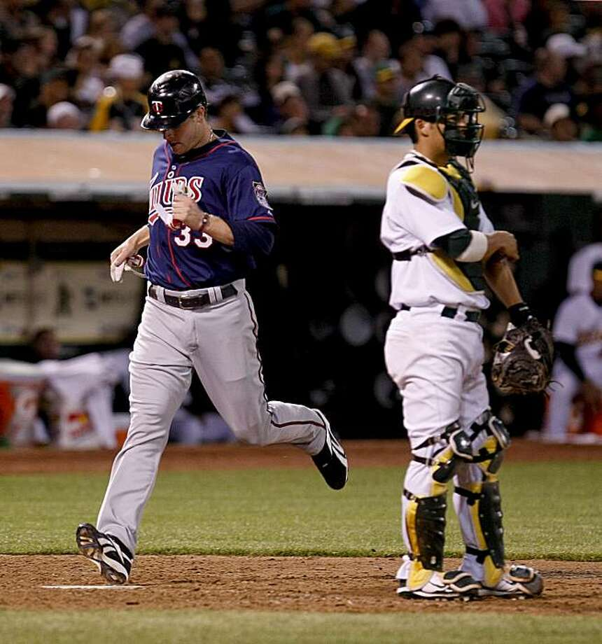 Minnesota's Justin Morneau scores the winning on a single by teammate Delmon YOung in the 12th inning as the Twins win 5-4.  Oakland Athletics take on the Minnesota Twins in Oakland, Calif. on Friday June 4, 2010. Photo: Michael Macor, The Chronicle