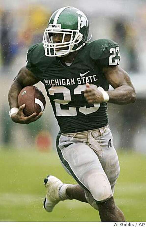 ** FILE ** In this Sept. 13, 2008 file photo, Michigan State's Javon Ringer runs for a 21-yard touchdown during the second quarter of an NCAA college football game against Florida Atlantic in East Lansing, Mich.When tailback Javon Ringer rushes for 100 yards or more, the Spartans are unbeaten at 5-0. When Ringer doesn't reach the century mark, Michigan State is 1-2. So it's no mystery what the Spartans will try to do Saturday when they seek their first win at archrival Michigan since 1990. (AP Photo/Al Goldis, File) Photo: Al Goldis, AP