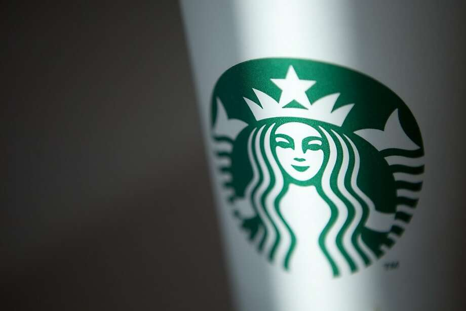 The Starbucks Corp. logo is displayed on a paper cup in Beijing, China, on Wednesday, Feb. 1, 2012. Starbucks is the world's largest coffee-shop chain. Photographer: Nelson Ching/Bloomberg Photo: Nelson Ching, Bloomberg