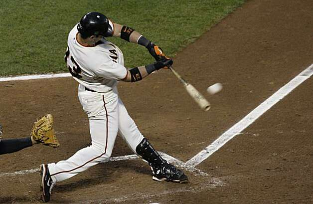 San Francisco Giants' Aaron Rowand hits a two-RBI double off of Colorado Rockies' Jeff Francis in the fifth inning of a baseball game in San Francisco, Wednesday, June 2, 2010. Photo: Jeff Chiu, AP