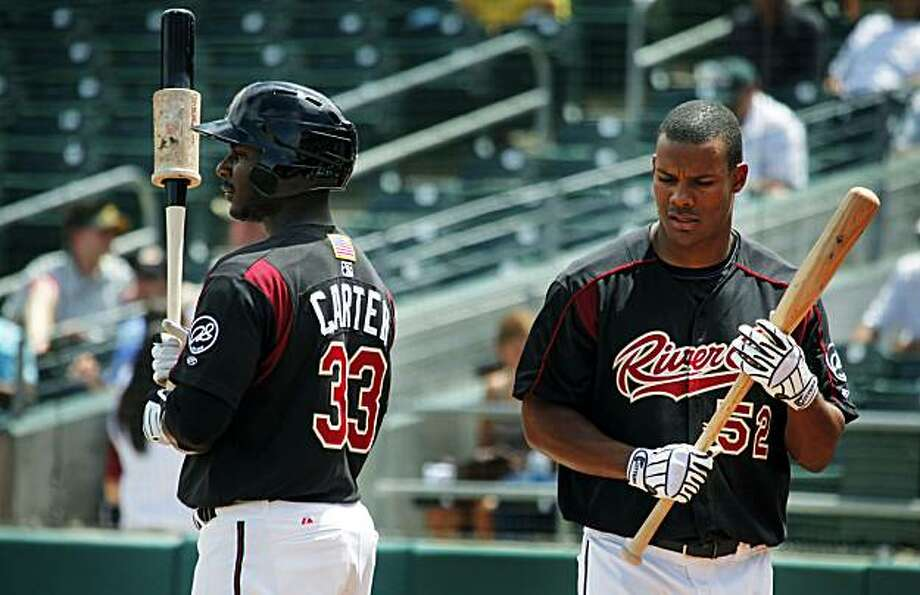 Oakland A's top prospects, The Sacramento River Cats Chris Carter #33 and Michael Taylor #52, warm up while being on desk during their game with the Tacoma Rainiers Wednesday June 2, 2010 at Raley Field in Sacramento loosing to Tacoma 9-7. Photo: Lance Iversen, The Chronicle