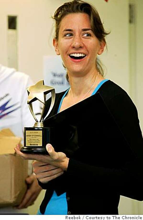 Arien O'Connell accepts a trophy In New York from the Reebok company in recognition of running the fastest time at the San Francisco Nike Women's Marathon. Photo: Reebok, Courtesy To The Chronicle
