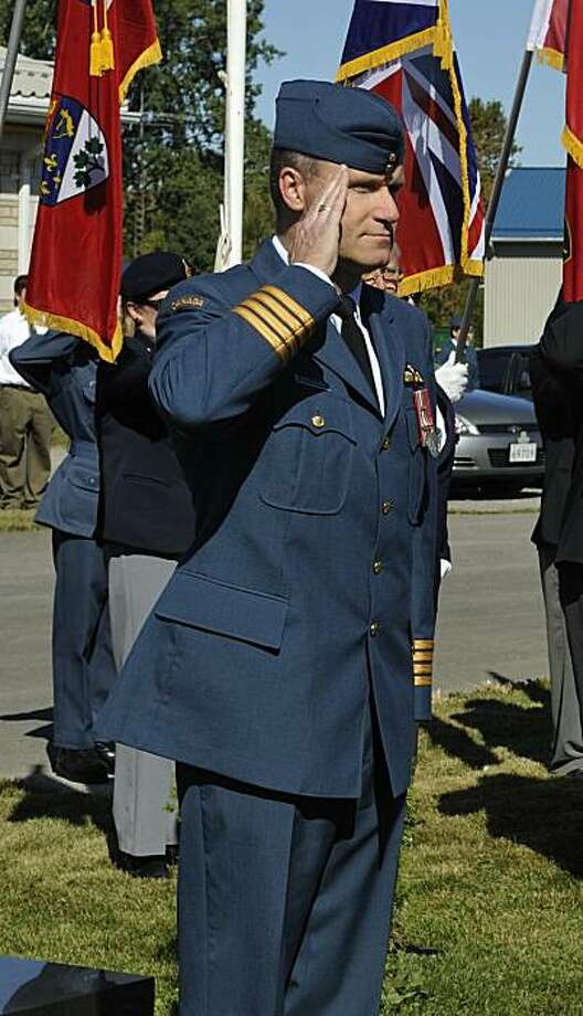 ** ADVANCE FOR SUNDAY, MAY 23 ** FILE - In this Sept. 20, 2009 file photo provided by the Dept. of National Defense via The Canadian Press, Col. Russell Williams salutes as he arrives at the Battle of Britain parade in Trenton, Ontario. The commander of Canada's largest Air Force base, who once flew dignitaries around the country, has been charged with first-degree murder in the deaths of two women. Photo: MCpl Miranda Langguth, AP
