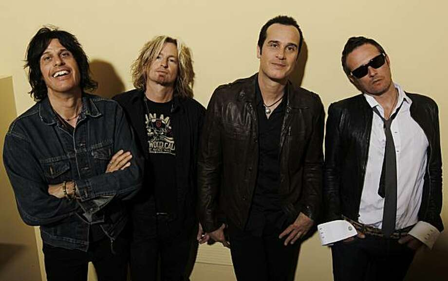 In this April 30, 2010 photo, members of Stone Temple Pilots, from  left, Dean Deleo, Eric Kretz, Robert Deleo, and Scott Weiland, pose for a portrait in Santa Monica, Calif. Photo: Matt Sayles, AP