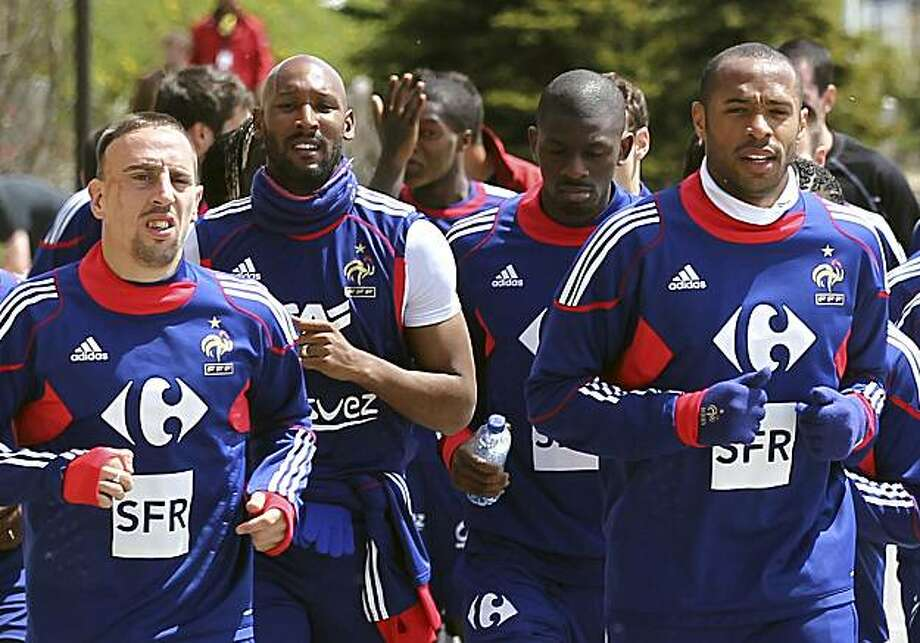 France soccer players, from left, Franck Ribery, Nicolas Anelka, Abou Diaby, and Thierry Henry run during a training session in Tignes, French Alps resort, Friday, May 21, 2010 as part of their altitude preparation for the 2010 World cup in South Africa. Photo: Francois Mori, AP