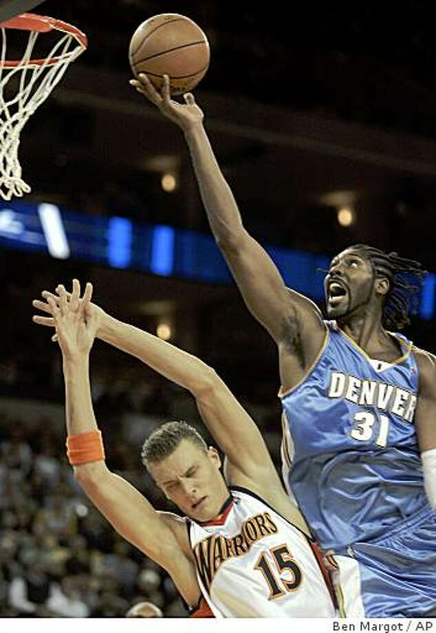 Denver Nuggets' Nene (31), of Brazil, goes up for a shot over Golden State Warriors' Andris Biedrins, of Latvia, during the second quarter of an NBA basketball game Wednesday, Nov. 5, 2008, in Oakland, Calif. (AP Photo/Ben Margot) Photo: Ben Margot, AP