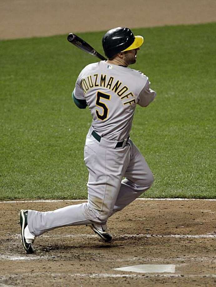Oakland Athletics' Kevin Kouzmanoff follows his three-RBI double against the Baltimore Orioles during the eighth inning of a baseball game, Thursday, May 27, 2010, in Baltimore. The Athletics won 7-5. Photo: Rob Carr, AP