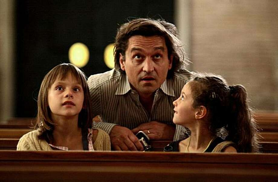 "Louis-Do de Lencquesaing and unidentified children in a still from ""The Father of My Children."" Photo: Outnow.com"