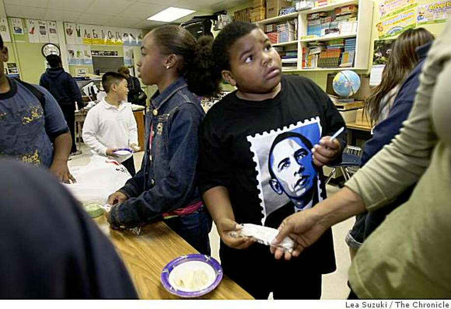 Manzanita Elementary School 5th grader Roger Hall, 11,  wears an Obama T-shirt as he prepares to add toppings to his bowl of ice cream during an ice cream party on Obama Day on Wednesday, November 5, 2008 in Oakland, Calif. Photo: Lea Suzuki, The Chronicle