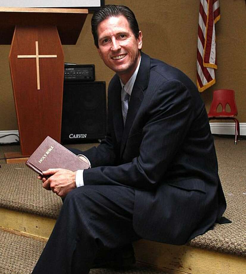 In this May 26, 2010 photo, Rev. Brian Hendry, of the Zion Fellowship church, and a pastor with the Better Courts Now organizaton, poses in his church in San Diego.  The conservative religious organization is trying to unseat judges in the upcoming California election. A group of conservative attorneys say they are on a mission from God to unseat four California judges in a rare challenge that is turning a traditionally snooze-button election into what both sides call a battle for the integrity of U.S. courts. Hendry and other supporters have launched the mostly online campaign to replace the incumbent judges, all Democrats, with Christian conservatives. Photo: Lenny Ignelzi, AP