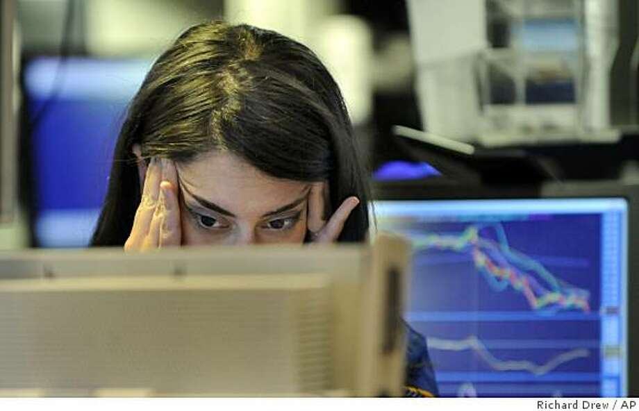 Specialist Elizabeth Rose looks at a screen at her post on the floor of the New York Stock Exchange on Wednesday. Volatility has returned on Wall Street, with the Dow Jones industrials falling 486 points to the 9,139 level, and all the major indexes tumbling more than 5 percent. Photo: Richard Drew, AP