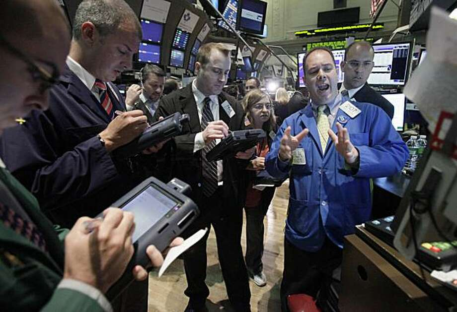 Specialist Thomas Warshaw, foreground right, directs trades in BP on the floor of the New York Stock Exchange Tuesday, June 1, 2010. Photo: Richard Drew, AP
