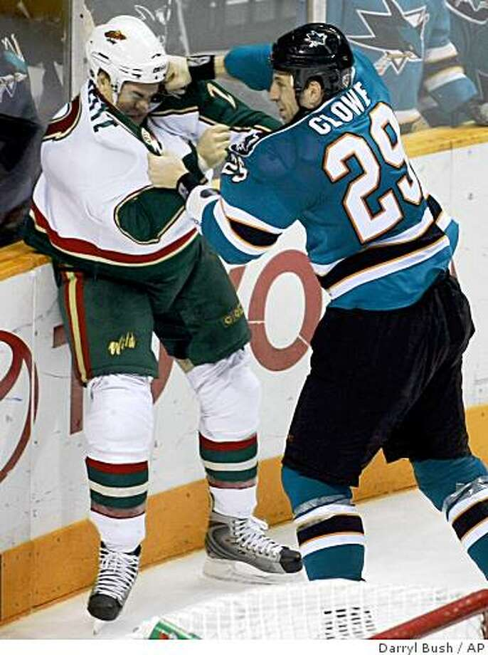 Minnesota Wild's Erik Reitz, left, is hit by San Jose Sharks left wing Ryane Clowe (29) as they fight in the third period in San Jose, Calif., Tuesday, Nov. 4, 2008. Photo: Darryl Bush, AP