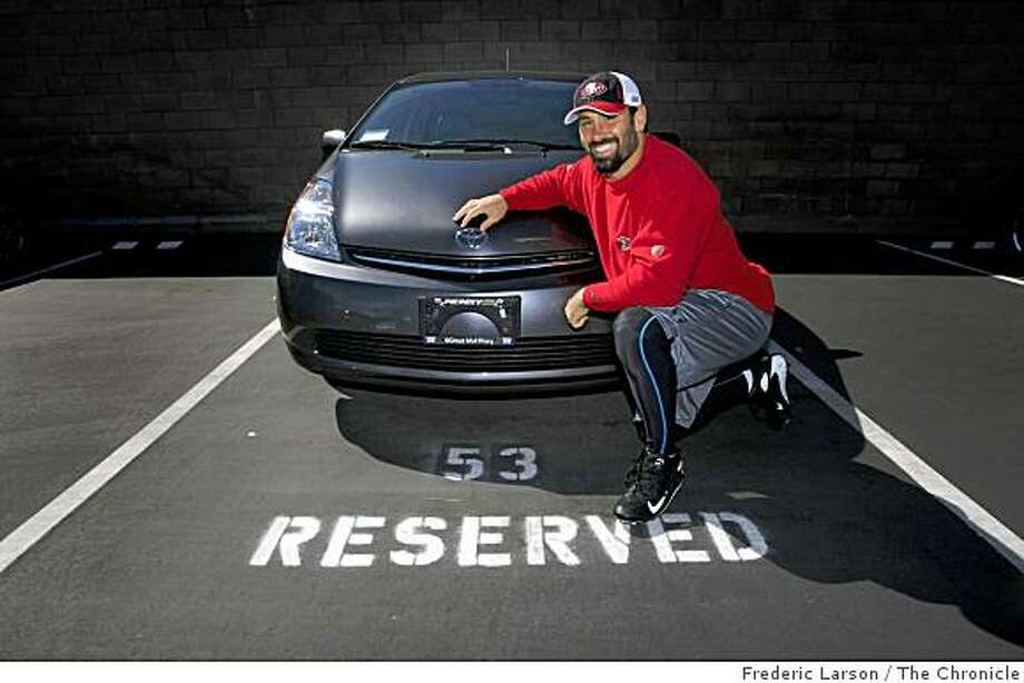 Jeff Ulbrich, 49ers linebacker poses by his eco-frendly Toyota Prius at his private parking spot at the 49ers headquarters in Santa Clara, Calif., on Friday, October 10, 2008. Photo: Frederic Larson, The Chronicle