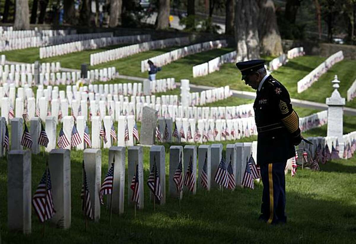 Jim Camarda, who served during World War II, pauses to look over the flag-decorated gravesites at the San Francisco National Cemetery, Monday, May 31, 2010, in San Francisco. The annual Memorial Day ceremony in the Presidio drew hundreds of veterans and others. (AP Photo/San Francisco Chronicle, Brant Ward) NORTHERN CALIFORNIA MANDATORY CREDIT PHOTOG & CHRONICLE; MAGS OUT; NO SALES