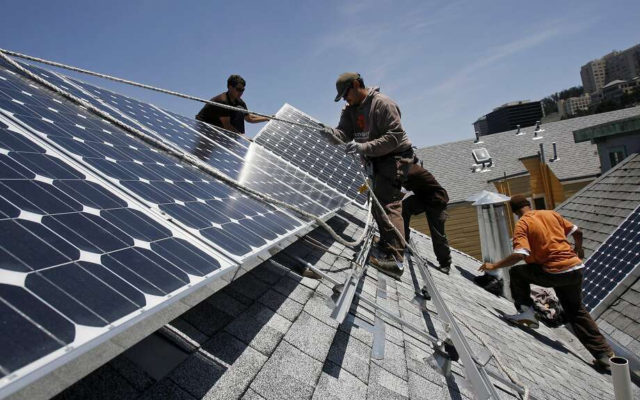 Installation crew members for Sungevity, from left, Jeremiah Eanes, Francois Hunter, Larry Galbert, and Lionel Gant, install solar panels on a home at 1236 6th Avenue in San Francisco, Calif., on Thursday, May 14, 2009. Sungevity, which is based out of Berkeley, Calif., installs solar panels on local homes and uses Microsoft Virtual Earth to calculate how to install them and what they will cost. Photo: Hardy Wilson, The Chronicle