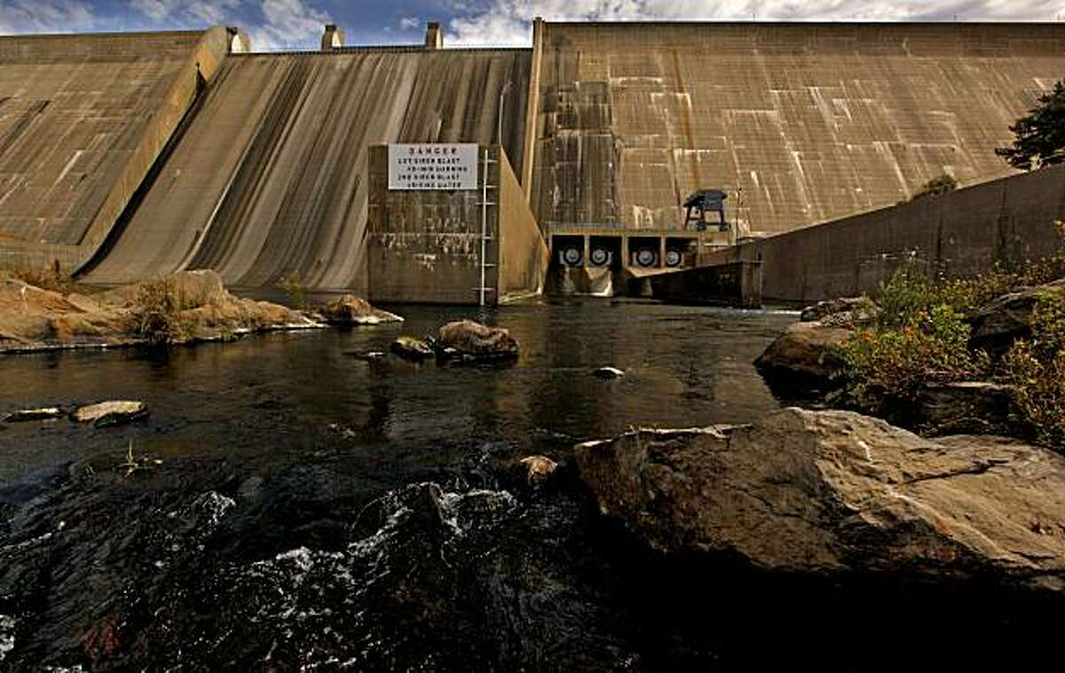 The Friant Dam, holds back the waters of Millerton Lake at Friant, Calif., on Tuesday September 29, 2009. As part of a landmark federal settlement, water will be released, Oct. 1, 2009, beginning the restoration of the San Joaquin River.