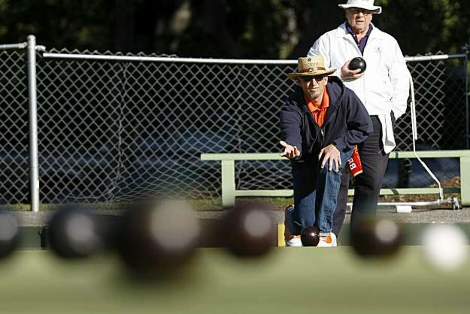 Ken Torke bowls as oppoment Ed Walker watches on in a game, Wednesday April28, 2010 at the Palo Alto Lawn Bowling Club in Palo Alto, Calif. Torke wakes up around 4 a.m. so that he can get off work early to stop by the club 4 or 5 times a week. Photo: Lacy Atkins, The Chronicle