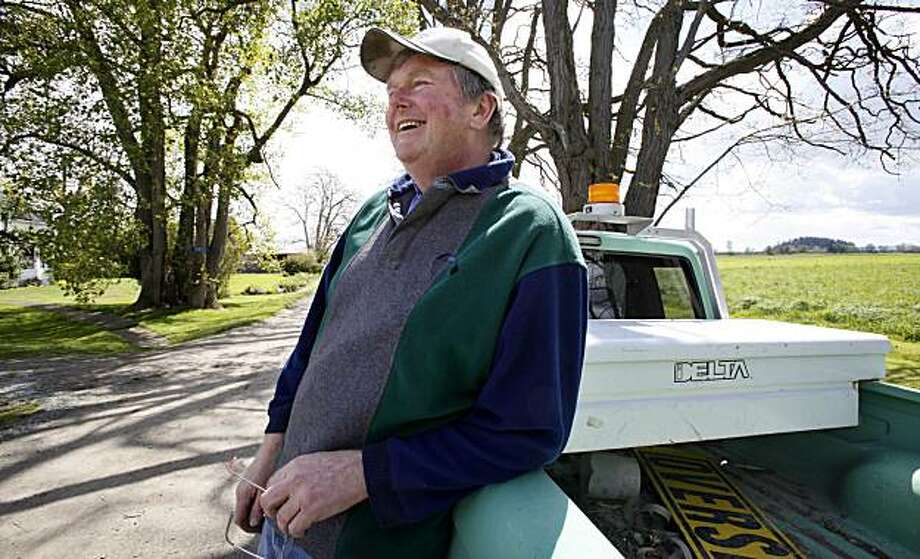 Dave Hedlin leans against his truck as he talks about having taken part in an experiment that flooded about 20 acres of his farmland to provide wetland habitat for migratory shorebirds near La Conner, Wash., May 3, 2010. Early results from a three-year pilot project to flood farmland show benefits for both birds and farmers, and offers a possible approach for other areas balancing conservation with agricultural production. Hundreds of shorebirds are using the fields to fatten up during spring and fall migrations, while farmers have seen spikes in nitrogen, a key plant fertilizer, in their fields. Photo: Elaine Thompson, AP