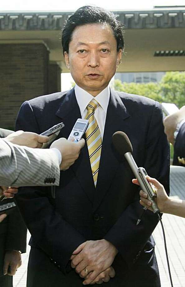Japan's Prime Minister Yukio Hatoyama answers to reporters questions in front of his official residence in Tokyo Wednesday morning, June 2, 2010. Public TV NHK says Hatoyama has decided to resign over handling of U.S. base row. Photo: AP