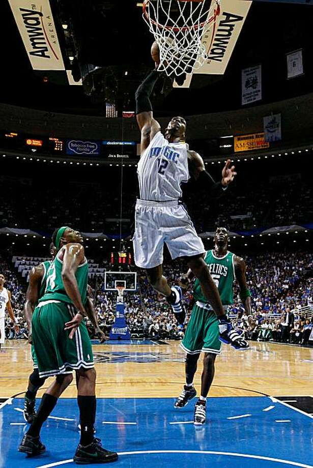 ORLANDO, FL - MAY 26:  Dwight Howard #12 of the Orlando Magic dunks against Paul Pierce #34 and Kevin Garnett #5 of the Boston Celtics in Game Five of the Eastern Conference Finals during the 2010 NBA Playoffs at Amway Arena on May 26, 2010 in Orlando, Florida. Photo: Kevin C. Cox, Getty Images