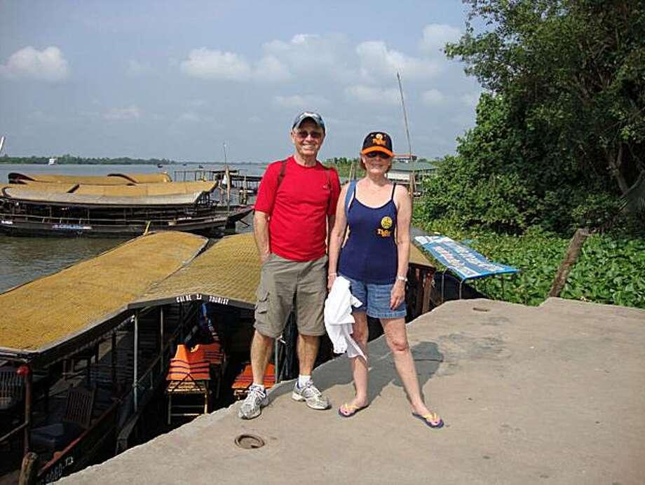 Richard & Susan Kreibich of Novato on the Mekong River, Vietnam. Photo: .