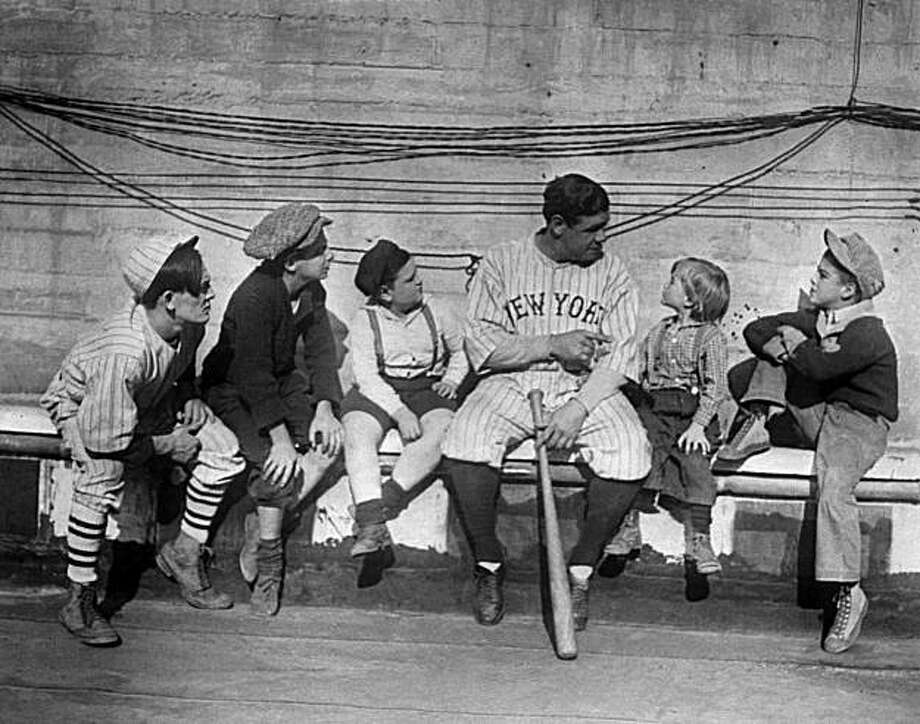 Youngsters lending an ear to Babe Ruth as he tells them stories of his life from orphanage to baseball fame, November 29, 1924. (AP Photo) Photo: AP