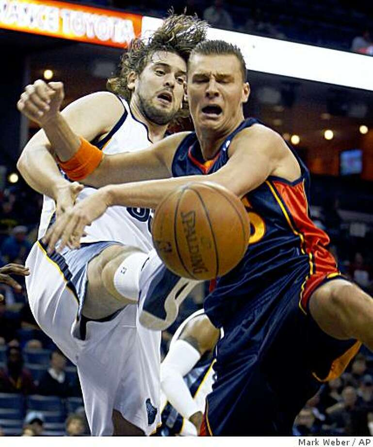 Memphis Grizzlies' Marc Gasol, left, of Spain, and Golden State Warriors' Andris Biedrins, of Latvia, watch a rebound get away during the first quarter of an NBA basketball game Monday, Nov. 3, 2008, in Memphis, Tenn. (AP Photo/Mark Weber) Photo: Mark Weber, AP