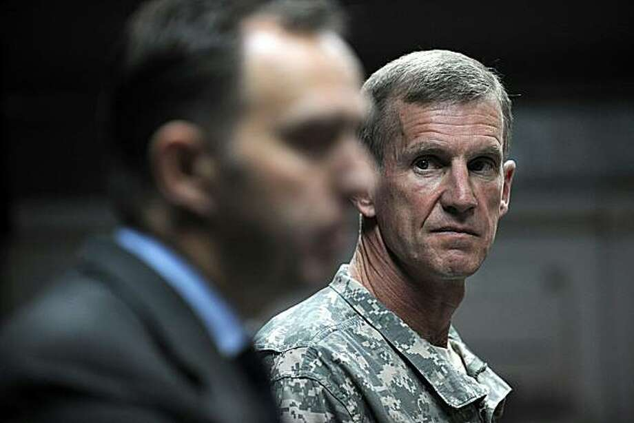 "NATO's Senior Civilian Representative in Afghanistan Mark Sedwill (L) speaks to media during a press conference while top US commander in Afghanistan General Stanley McChrystal (R) looks on in Kabul on May 30, 2010. A huge ""peace jirga"" set to take placein Kabul this week marks a critical moment in bringing an end to decades of conflict that have blighted Afghanistan, NATO leaders said on May 30. The National Consultative Peace Jirga, or assembly, aims to bring together leaders from across Afghanistan, representing the country's complicated mix of ethnic, tribal, geographic and gender interests. Photo: Shah Marai, AFP/Getty Images"