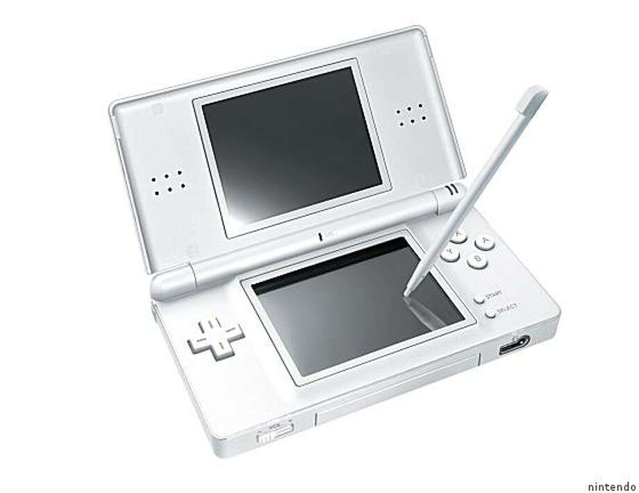 this is the nintendo DS Lite portable gaming deviceRan on: 08-14-2006 Photo: Nintendo
