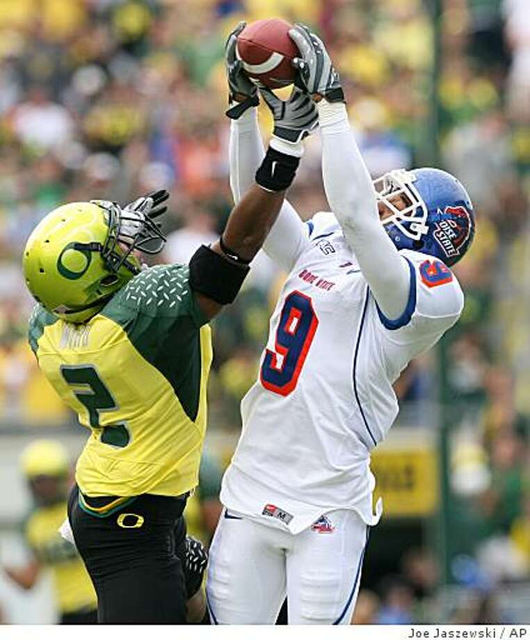 Boise State wide receiver Jeremy Childs, right, catches a pass over Oregon defensive back T.J. Ward, left, during an NCAA college football game at Autzen Stadium in Eugene, Ore., on Saturday afternoon, Sept. 20, 2008. (AP Photo/The Idaho Satesman,Joe Jaszewski ) ** MANDATORY CREDIT ** Photo: Joe Jaszewski, AP