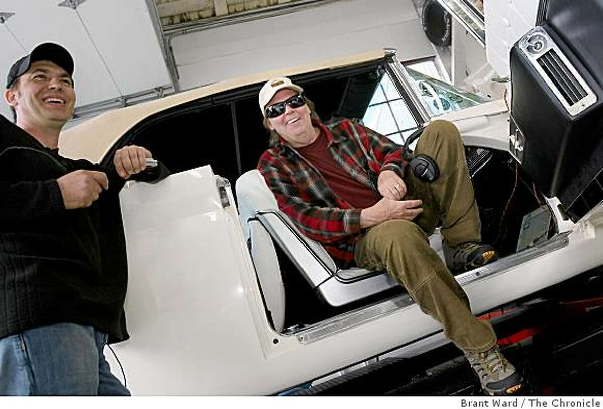 Johnathan Goodwin, who supervised the testing, and Neil Young.Neil Young is teaming up with a company in Wichita, Kansas and Salesforce.com to promote the idea of converting existing gas-guzzling cars into vehicles that run on alternate energy. He stopped by a garage Sunday November 2, 2008 to test his 1959 Lincoln Continental.