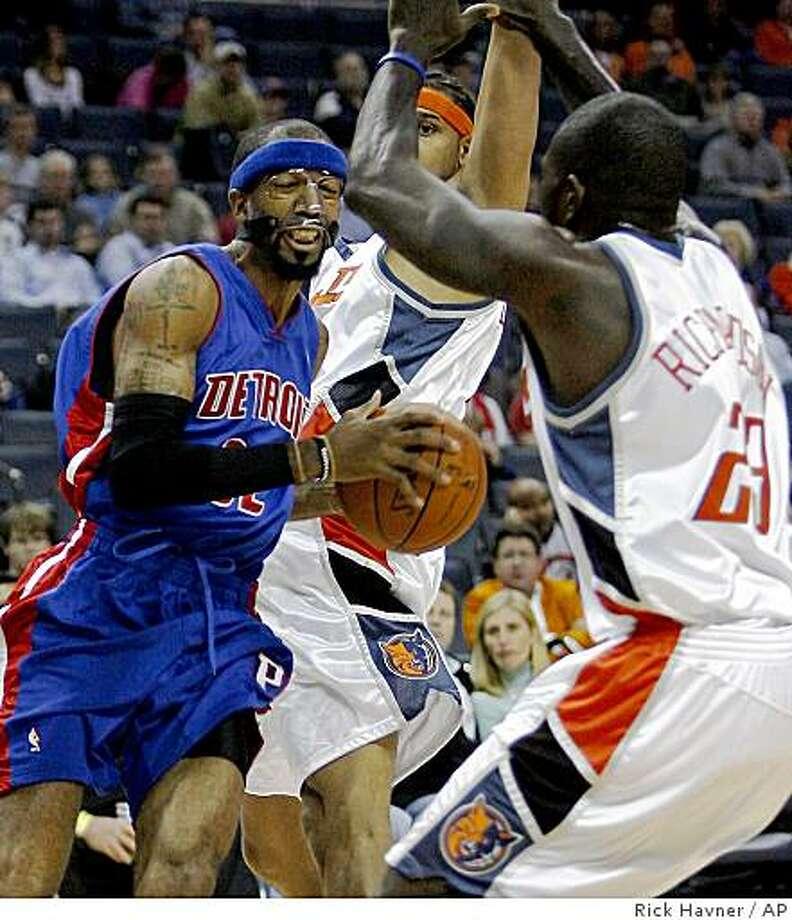 Detroit Pistons' Richard Hamilton, left, drives to the basket as Charlotte Bobcats' Jason Richardson, right, and Jared Dudley defend during the first half of an NBA basketball game Monday, Nov. 3, 2008, in Charlotte, N.C. (AP Photo/Rick Havner) Photo: Rick Havner, AP