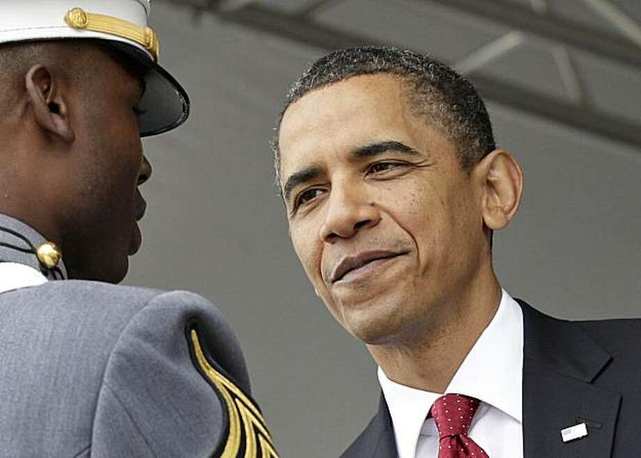 President Barack Obama congratulates Class President Arron Conley, and all the graduates of the U.S. Military Academy, Saturday, May 22, 2010, in West Point, N.Y. Photo: J. Scott Applewhite, AP