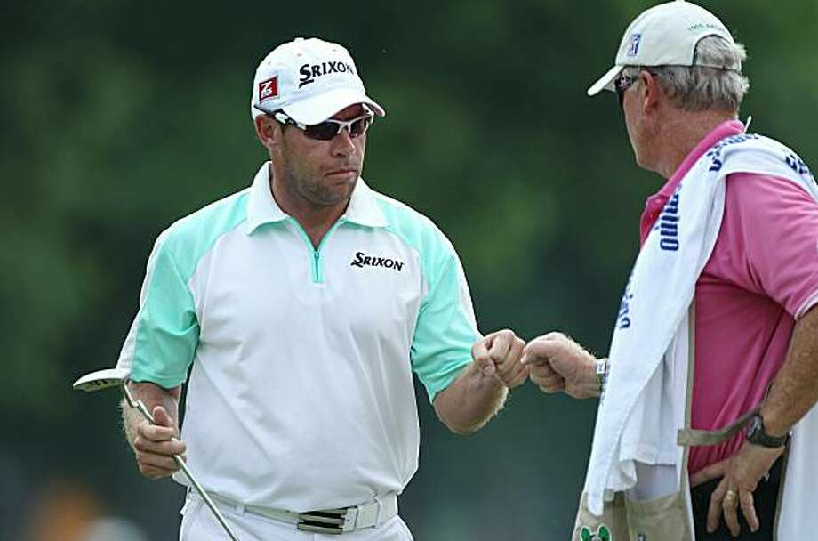 FT. WORTH, TX - MAY 29:  Brian Davis of England celebrates with his caddie Steve Hulka after making birdie on the 11th hole during the third round of the 2010 Crowne Plaza Invitational at the Colonial Country Club on May 29, 2010 in Ft. Worth, Texas. Photo: Scott Halleran, Getty Images