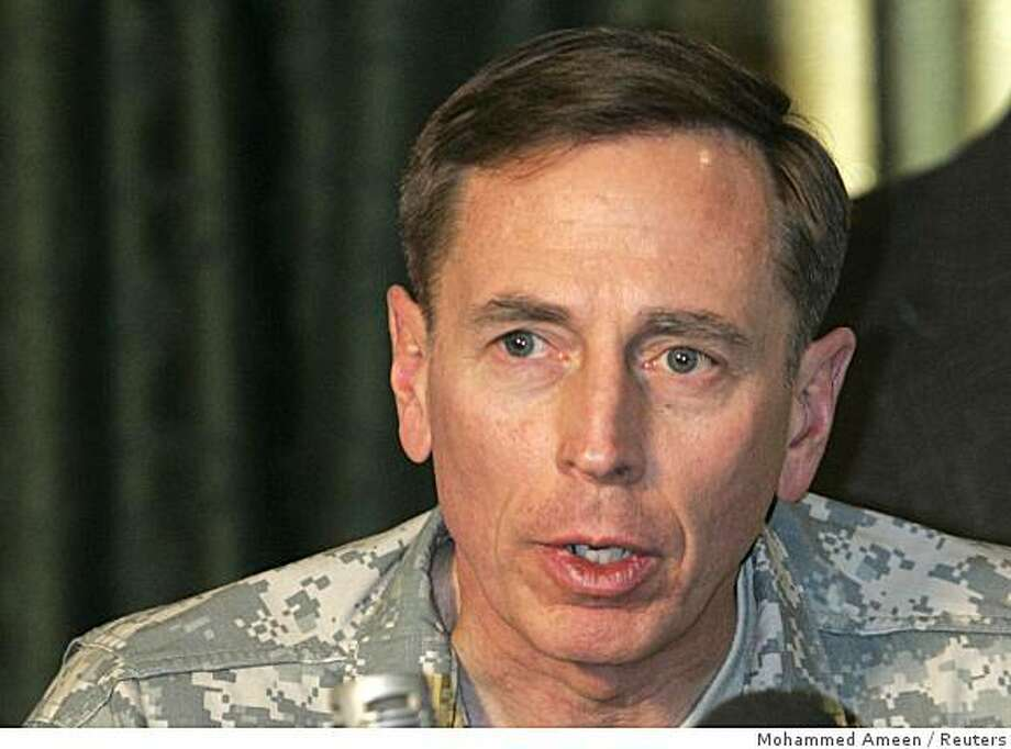 U.S. commander in Iraq General David Petraeus speaks during a meeting with tribal members of the awakening council, in Baghdad December 13, 2007. REUTERS Photo: Mohammed Ameen, Reuters