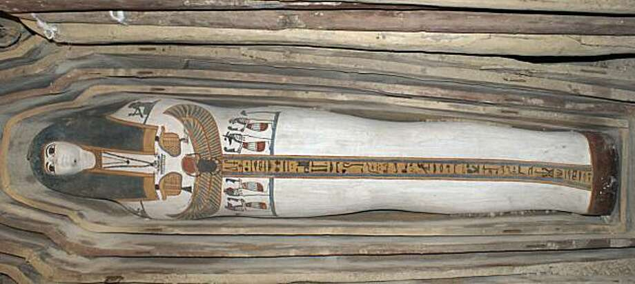 This undated photo released by the Egyptian Supreme Council of Antiquities on Sunday, May 23, 2010, shows a painted wooden sarcophagus discovered in Lahoun, near Fayoum, some 70 miles (100 kilometers) south of Cairo, in Egypt. The Supreme Council of Antiquities says archeologists have unearthed 57 ancient Egyptian tombs, most of them containing a painted wooden sarcophagus with a mummy inside, with the oldest tombs dating back to around 2750 B.C. and twelve of the tombs belonging to the 18th dynasty whichruled Egypt during the second millennium B.C. Photo: Supreme Council Of Antiquities, AP