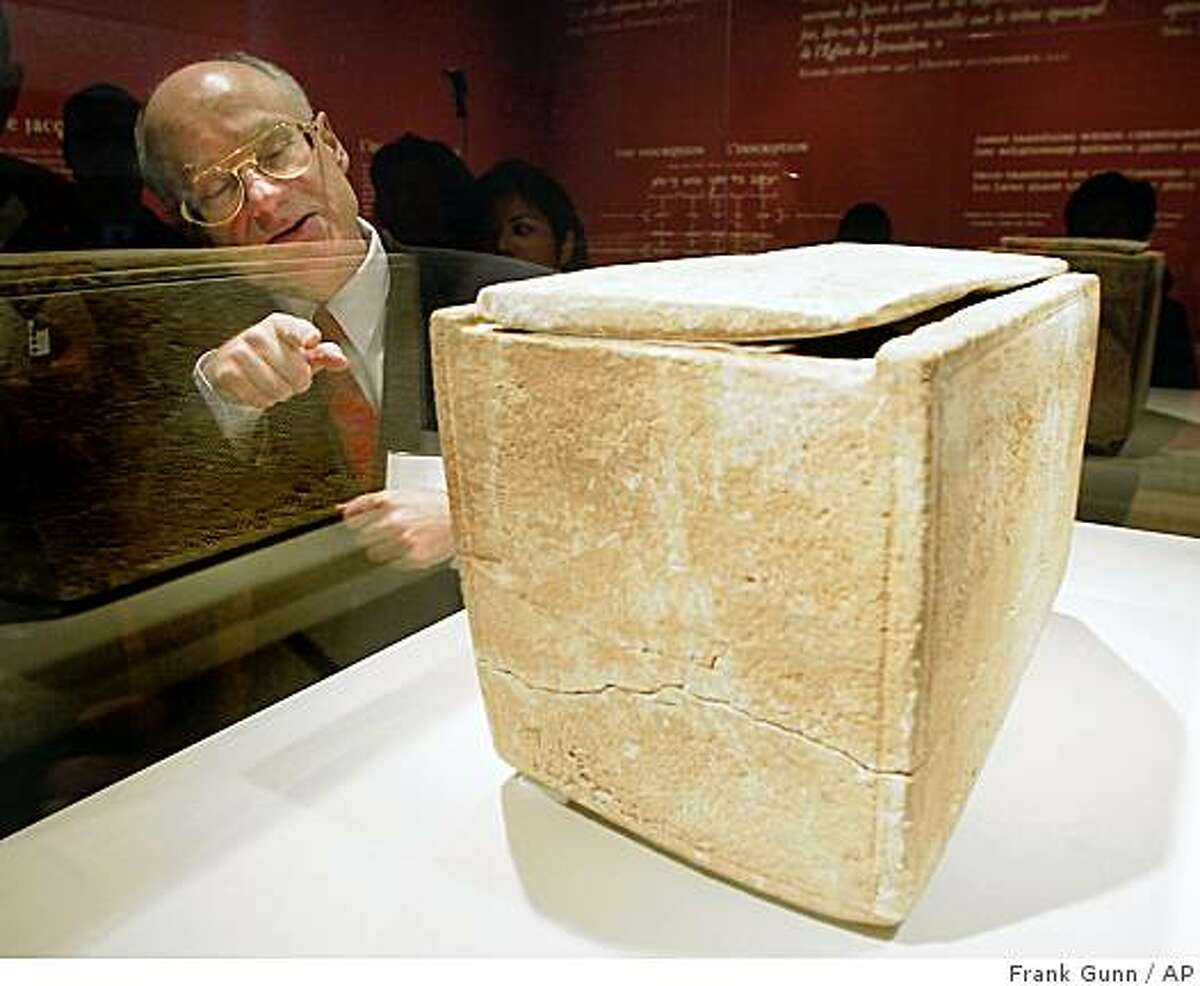 Israeli Consul General Meir Romem inspects damage to the James Ossuary during its media unveiling at the Royal Ontario Museum in Toronto, Canada in this Nov. 14, 2002 file picture. The ancient burial box purported to have held the bones of Jesus' brother James is a fake, Israel's Antiquities Authority said Wednesday June 18, 2003.
