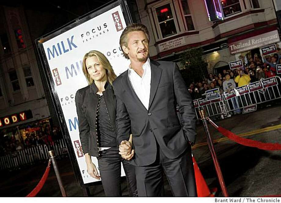 "Sean Penn and his wife, Robin Wright Penn, arrive at the premiere of the Gus Van Sant film ""Milk"" . A benefit screening of the film ""Milk"" was shown at the Castro Theatre in San Francisco, Calif., on Tuesday, October 28, 2008. Photo: Brant Ward, The Chronicle"