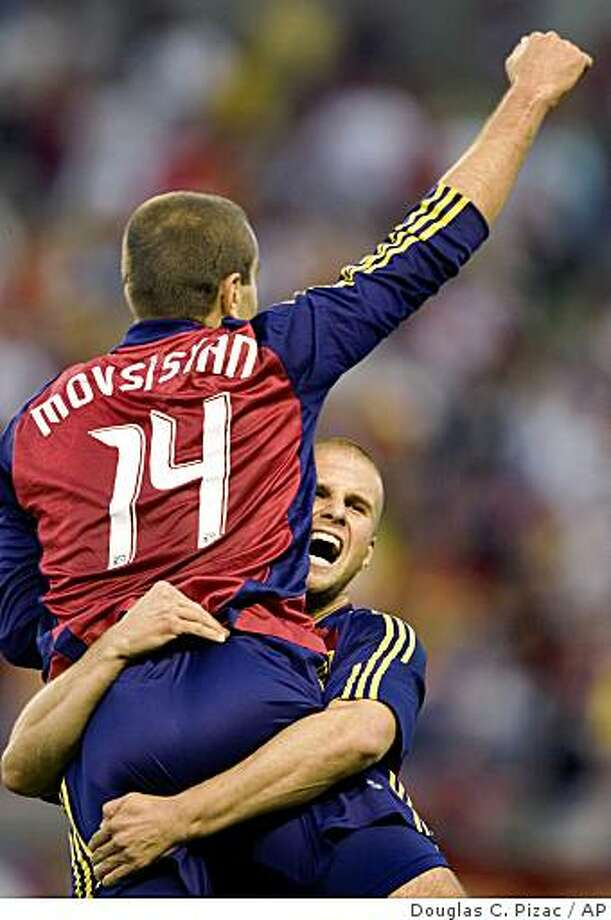 Real Salt Lake forward Yura Movsisyan (14) is lifted by teammate Chris Wingert after beating Chivas USA 1-0 in an MLS playoff game Saturday, Nov. 1, 2008, in Sandy, Utah. Photo: Douglas C. Pizac, AP