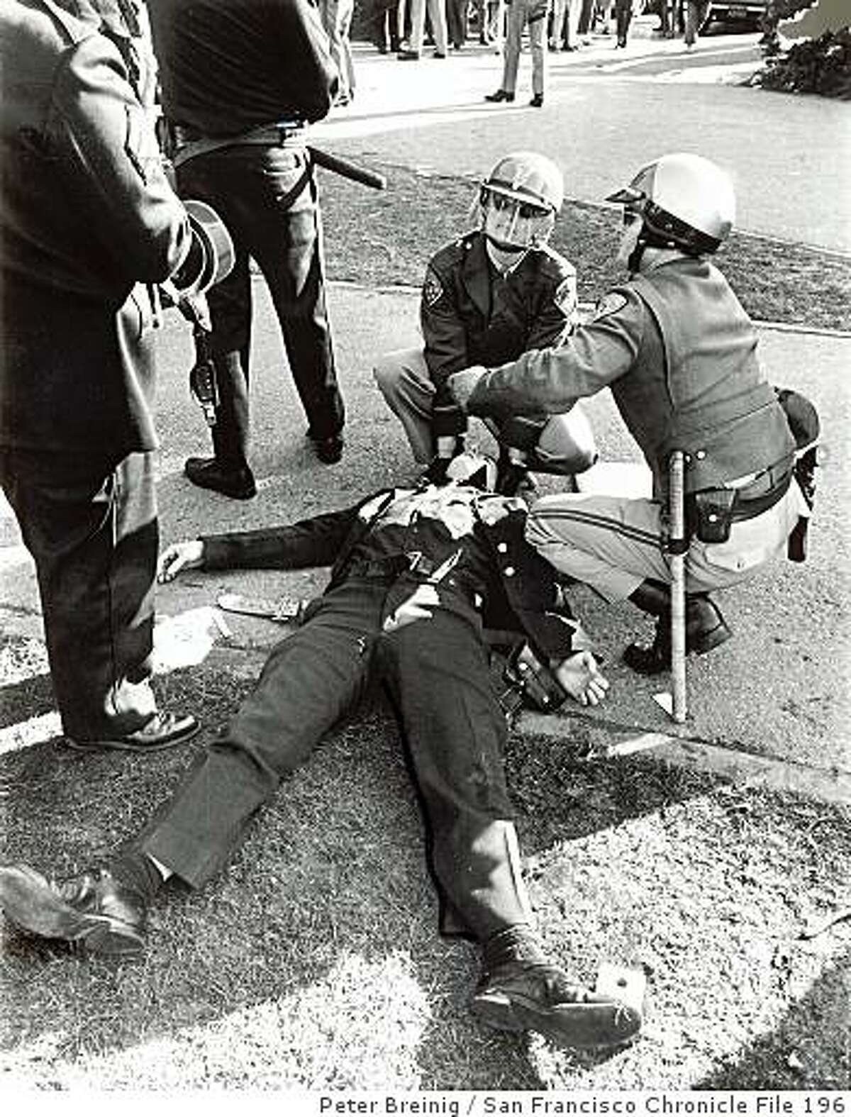 mr02_ph2.jpg December 3, 1968 - Policeman Paul Juel of the San Francisco police department lies unconscious on the San Francisco State University campus after being felled by a hunk of brick thrown during a melee between police and dissident students. He was struck on the back of the neck. Minority groups on strike at the college for a month have tried to close it down again since it was reopened for classes. The projectile is held by an SFPD officer.Peter Breinig/ San Francisco Chronicle File 1968