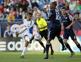 FOXBORO, MA - MAY 15:   Chris Wondolowski #8 of the San Jose Earthquakes shoots on net against Cory Gibbs #12 of the New England Revolution in front of the net at Gillette Stadium on May 15, 2010 in Foxboro, Massachusetts.