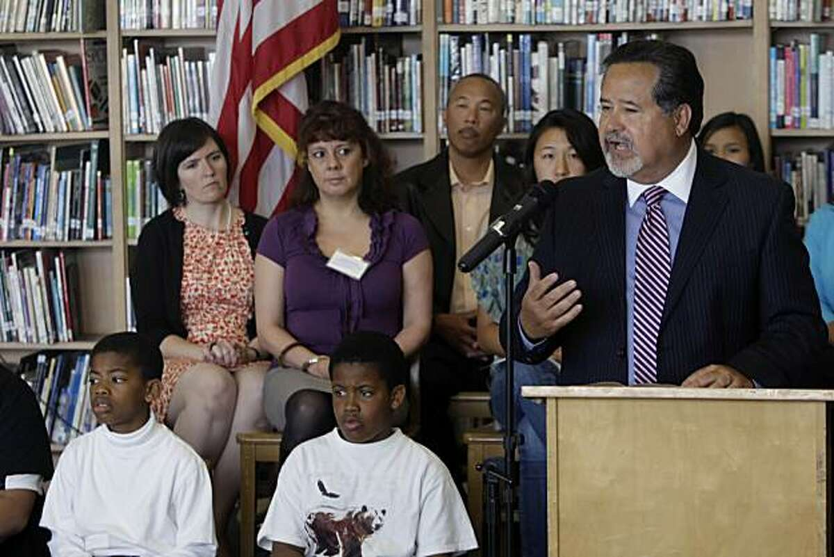 Superintendent Carlos Garcia (right) announces the filing of a lawsuit against the State of California requesting the current education finance system be declared unconstitutional and that the state be required to establish a school finance system that provides all students an equal opportunity to meet the academic goals set by the State at A.P. Giannini Middle School in San Francisco, Calif. on Thursday, May 20, 2010.