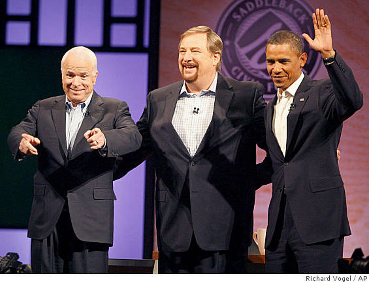 Democratic presidential candidate Sen. Barack Obama, D-Ill., right and Republican presidential candidate Sen. John McCain, R-Ariz., left and Pastor Rick Warren, greet parishioners during a non-debate forum moderated by Warren at the Saddleback Church in Lake Forest, Calif. on Saturday Aug. 16, 2008. (AP Photo/Richard Vogel)