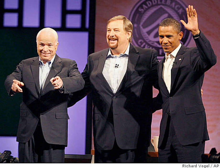 Democratic presidential candidate Sen. Barack Obama, D-Ill.,  right and Republican presidential candidate Sen. John McCain, R-Ariz., left and Pastor Rick Warren, greet parishioners during a non-debate forum moderated by Warren at the Saddleback Church in Lake Forest, Calif. on Saturday Aug. 16, 2008.  (AP Photo/Richard Vogel) Photo: Richard Vogel, AP
