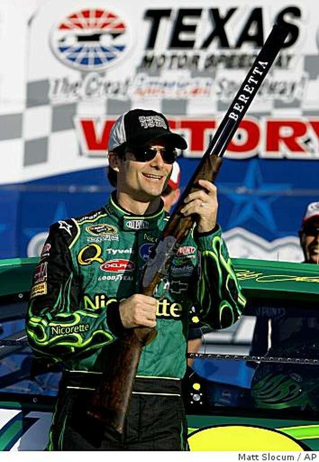 NASCAR Sprint Series driver Jeff Gordon smiles as he holds the Dickies 500 auto race pole sitter award at Texas Motor Speedway in Fort Worth, Texas., Friday, October 31, 2008. (AP Photo/Matt Slocum) Photo: Matt Slocum, AP