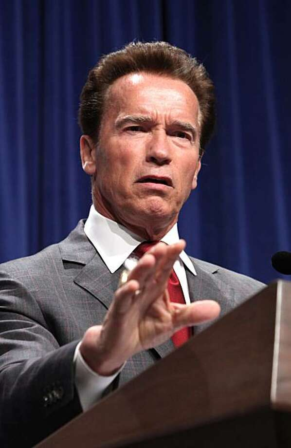 Gov. Arnold Schwarzenegger gestures as he responds to a question about his revised state spending plan he released at a news conference in Sacramento, Calif., Friday, May 14, 2010. Schwarzenegger's proposal called for eliminating California's welfare-to-work program to close a $19 billion budget deficit in the coming fiscal year. Photo: Rich Pedroncelli, AP